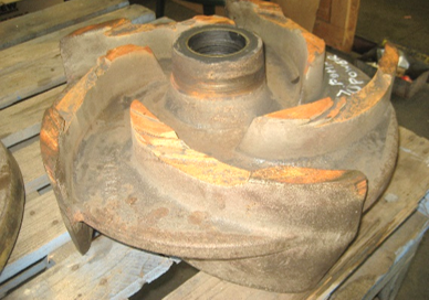 Worn out impeller before repair