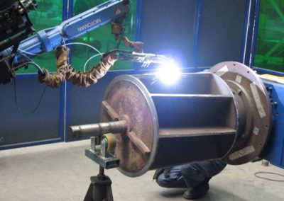 Rotary valve rotors are robotically hardfaced with tungsten carbide