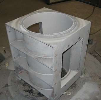 Rotary valve housing lined with tungsten carbide