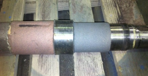 Metal spray shaft repair before grinding