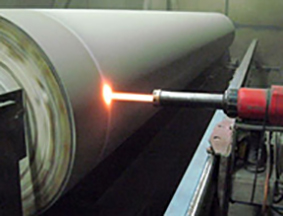 HVOF spraying tungsten carbide on a paper roller