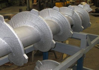 Robotically welded screw hardfacing