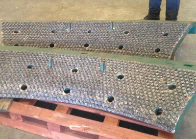 AbrasaStud lining of crusher wear plates