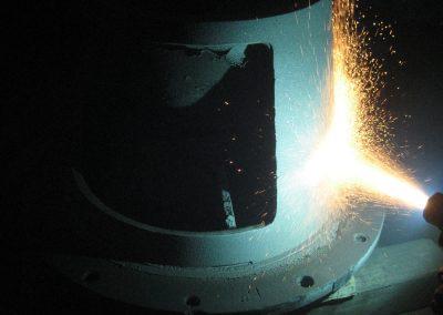Vacuum pumps repaired using metal spray and hardfacing